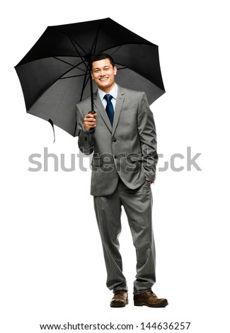 businessman holding umbrella - stock photo