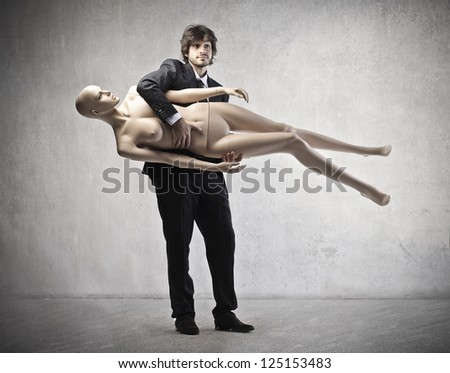 Businessman holding under the arm - stock photo