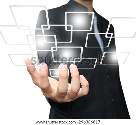 Businessman holding virtual button - stock photo