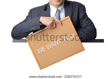 businessman holding we want you board isolated on white background ,recruitment concept - stock photo
