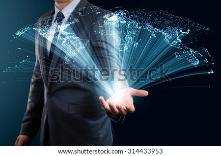 businessman holding world map made from glow line - stock photo