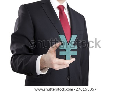 Businessman holding yen sign with clipping path  - stock photo