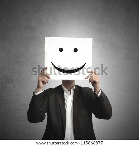 Businessman holds a paper with a smile - stock photo