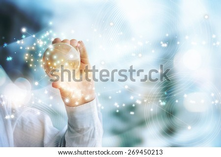 Businessman holds Earth in a hand - stock photo