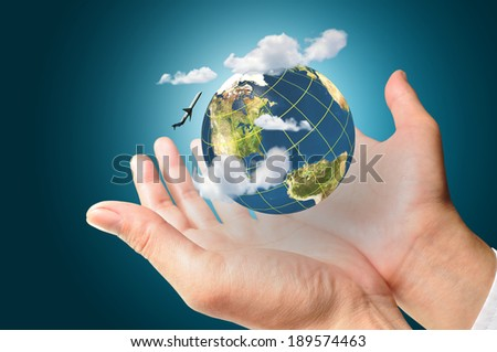 Businessman holds Earth in a hand with airplane and cloud present air transportation concept. Elements of this image furnished by NASA  - stock photo