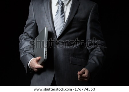 businessman holds laptop - stock photo