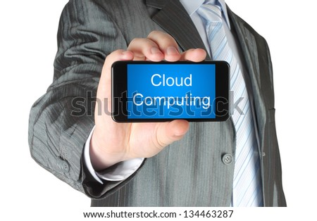 Businessman holds smart phone with cloud computing words on white background - stock photo