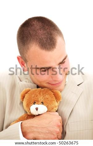 Businessman hugging a teddy-bear - stock photo