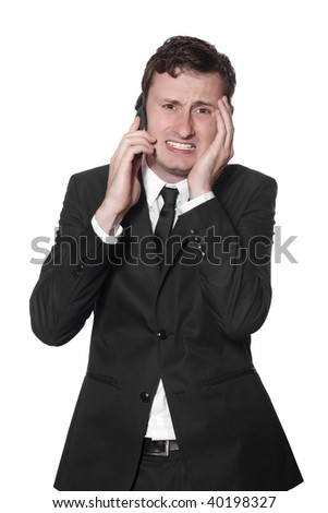 businessman in a black suit and a mobile phone with headache isolated on white - stock photo