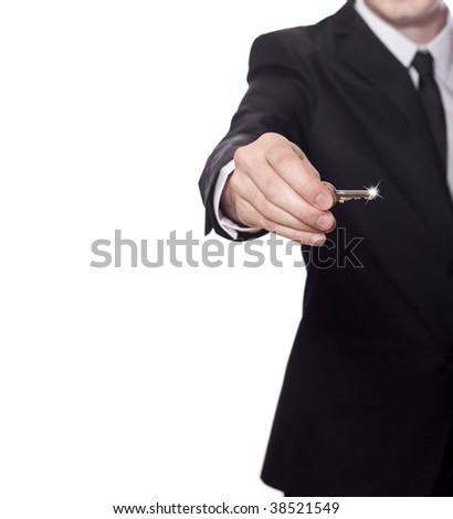 businessman in a black suit has the key to success, photo with a lot of copy space - stock photo