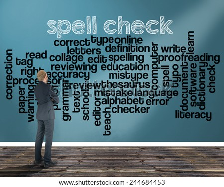 businessman in a room looking at a wall of which is the wordcloud related to spell check - stock photo