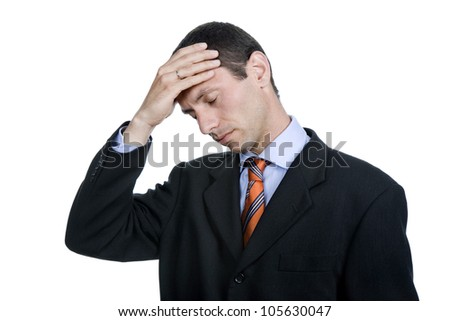 Businessman in a suit gestures with a headache - stock photo