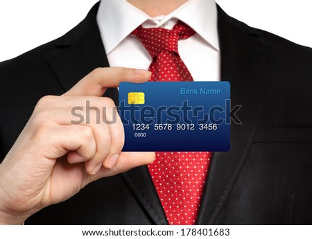 businessman in a suit holding a credit card - stock photo