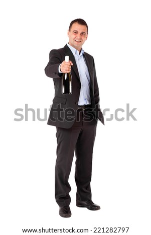 Businessman in a suit holding sparkling wine bottle. Isolated with work path. - stock photo