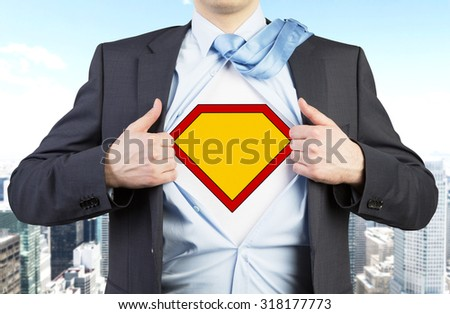 Businessman in a suit is tearing the shirt. Yellow figure on the chest as a symbol of the power and success. New York city view on the background. - stock photo