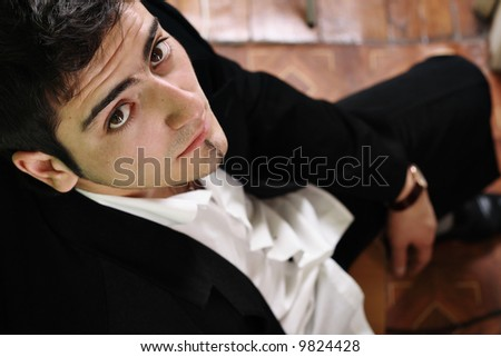 Businessman in a suit looking up. Stress - stock photo