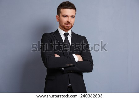 businessman in a suit smiling - stock photo