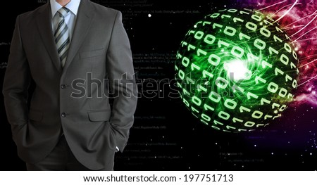 Businessman in a suit. Spheres of glowing digits on background - stock photo