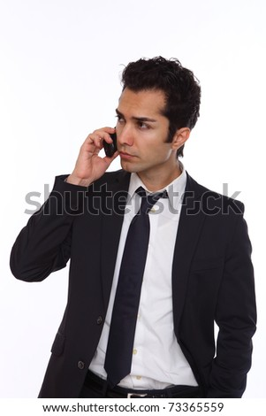 Businessman in a suit talking on his wireless phone - stock photo