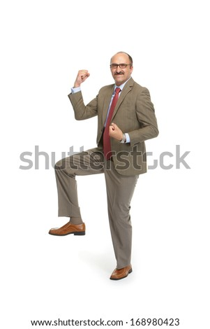 Businessman in a tie on a white background - stock photo