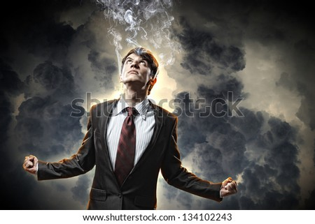 businessman in anger with fists clenched and steam above head - stock photo