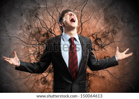 businessman in anger with fists clenched screaming - stock photo