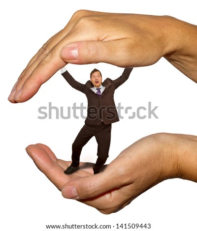 Businessman in big hands - stock photo