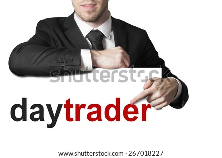 businessman in black suit pointing on sign daytrader isolated - stock photo