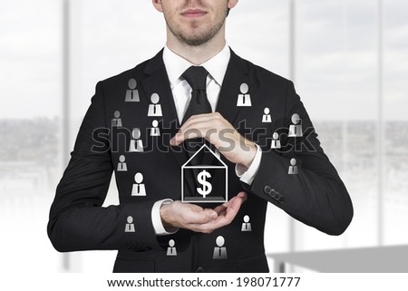 businessman in black suit protecting house with dollar symbol and employees with hands - stock photo