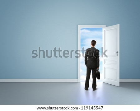 businessman in blue room with door in sky - stock photo