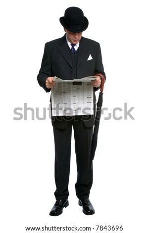 Businessman in bowler hat and three piece pinstripe suit reading a financial newspaper. - stock photo