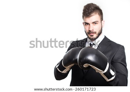 Businessman in boxing gloves - stock photo