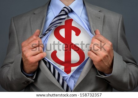 Businessman in classic superman pose tearing his shirt open to reveal a dollar symbol on chest concept for human financial advisor, success or recruitment - stock photo