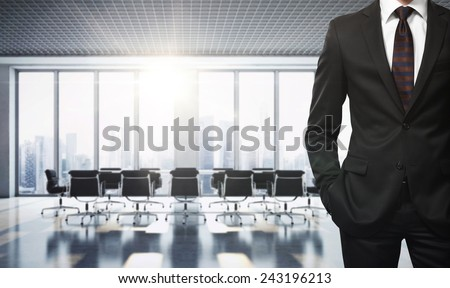 Businessman in contemporary office - stock photo