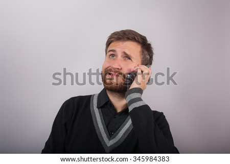 Businessman in distress speaks by phone - stock photo