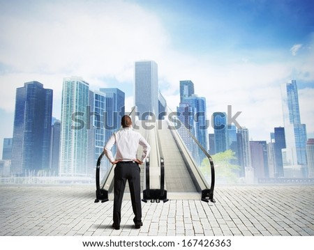 Businessman in front of a stairs to success - stock photo