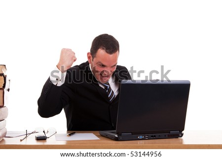 businessman in front of the computer, arm raised and happy, isolated on white background. Studio shot. - stock photo