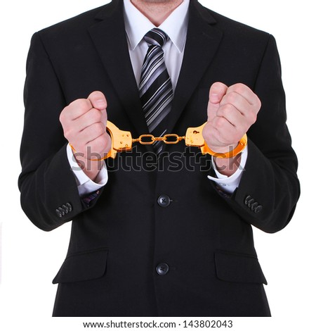 businessman in gold handcuffs arrested isolated on white background - stock photo