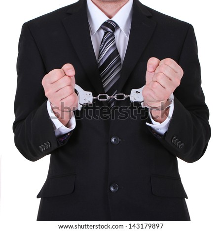businessman in handcuffs arrested isolated on white background - stock photo