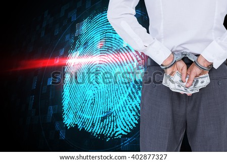 Businessman in handcuffs holding bribe against digital security finger print scan - stock photo