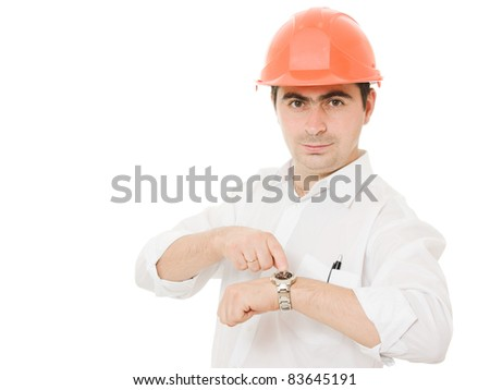 Businessman in helmet looks at his watch. - stock photo
