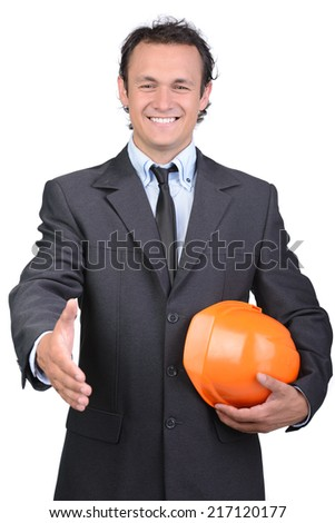 Businessman in helmet offering handshake over white background - stock photo