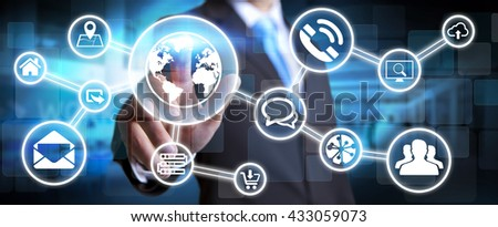 Businessman in his office using a digital tactile screen interface with web icons - stock photo