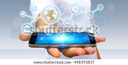 Businessman in his office using a digital web network with his mobile phone '3D rendering' - stock photo