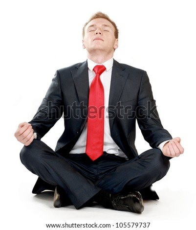 businessman in lotus pose - stock photo