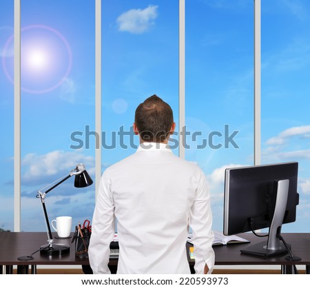 businessman in office and looking to big window - stock photo