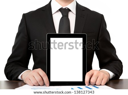 businessman in office holding tablet computer with isolated screen - stock photo