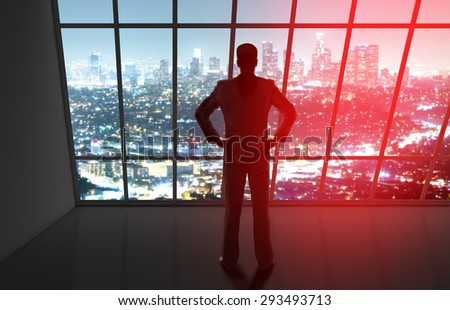 businessman in office looking to night city - stock photo