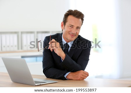 Businessman in office meeting business partner - stock photo