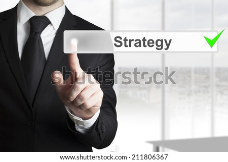 businessman in office pushing button strategy checked - stock photo